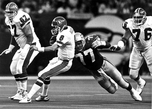 DE Jeff Bryant sacks Broncos QB Tommy Maddox at the KingDome