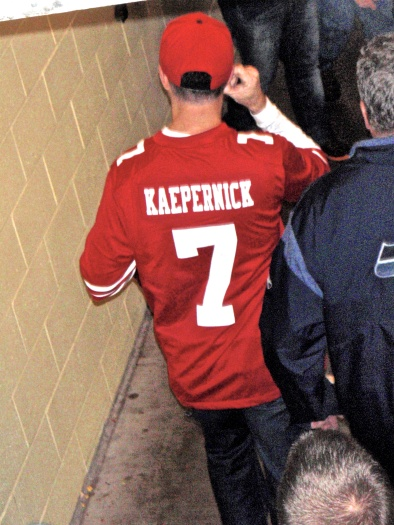 A member of The Faithful leaving early in the 4th quarter while removing ear plugs.